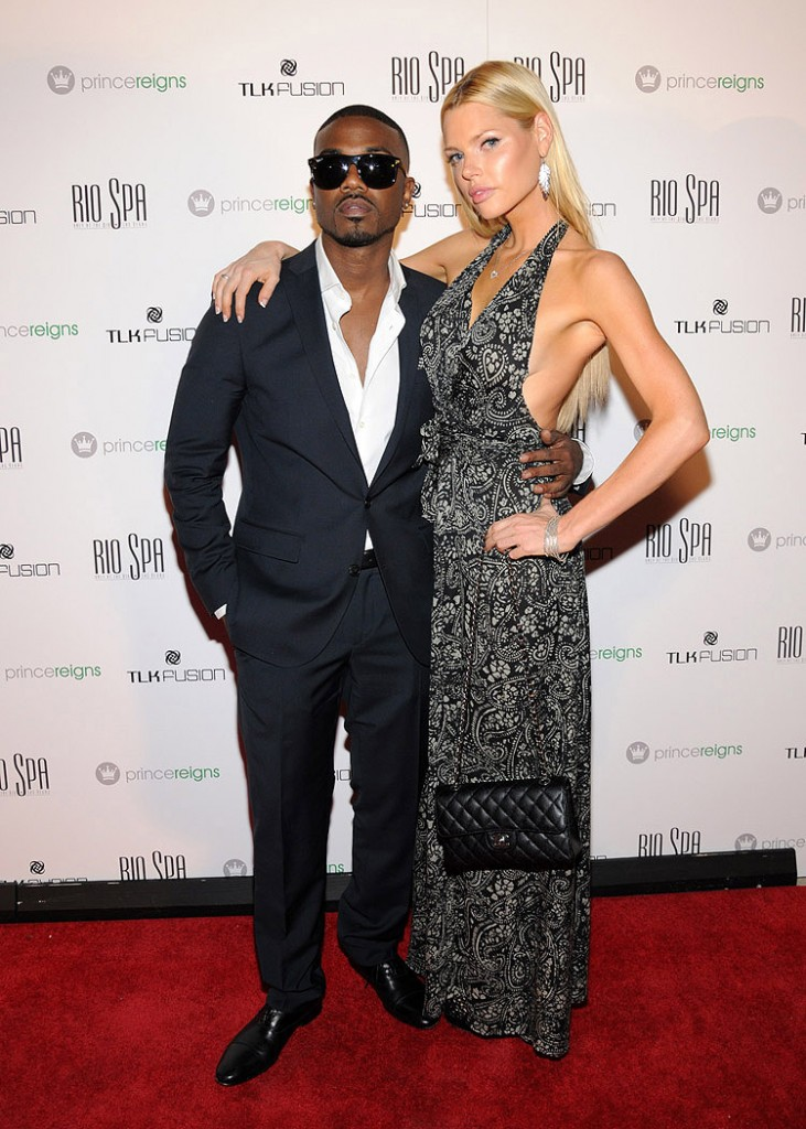 The faces of Prince Reigns, R&amp;B artist Ray J and model Sophie Monk, pose on the red carpet for the product launch party.